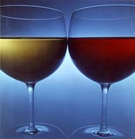 Two wine glasses on blue