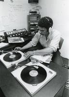 Student DJ in the WIIT studio, Illinois Institute of Technology, Chicago, Illinois, ca. 1980s