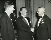 Henry Heald, Ludwig Mies van der Rohe, and James Cunningham at Mies' appointment dinner, Chicago, Illinois, 1938