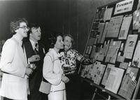 "Looking at ""IIT in the Media Eye"" clippings, Illinois Institute of Technology, Chicago, IL, ca. 1980"