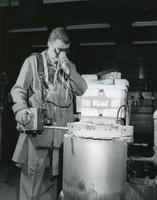 Armour Research Foundation ceramics engineer using optical pyrometer, Illinois Institute of Technology, Chicago, Illinois, ca. 1940s