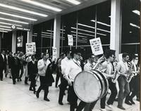 IIT students and faculty meeting the victorious College Bowl team at O'Hare Airport, Chicago, Illinois, 1964