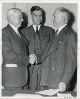 James Cunningham, Henry  Heald, and Alex Bailey after signing the merger agreement between Armour Institute and Lewis Institute, Chicago, Illinois, October, 1939