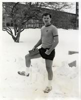 Unidentified student wearing shorts and a t-shirt in the snow, Illinois Institute of Technology, Chicago, Illinois, ca. 1980