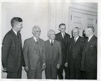 Henry Heald, Clarence Clarke, Fred Rogers, Dr. Linton Grinter, James Cunningham, and Alex Bailey after signing the merger agreement between Armour Institute and Lewis Institute, Chicago, Illinois, October, 1939