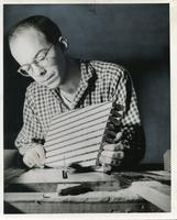 Jack Waldheim working on a woodcut with a circular saw, Chicago School of Design/Institute of Design, Chicago, Illinois, ca. early 1940s